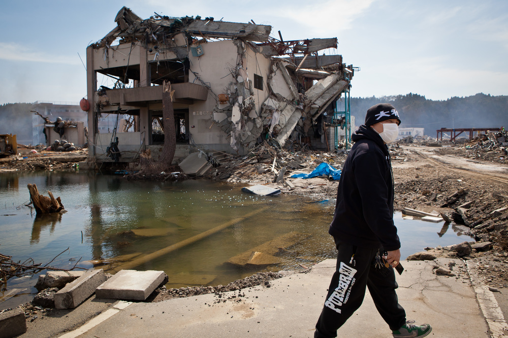 Enson Inoue surveying the damage after the 2011 Tohoku disaster
