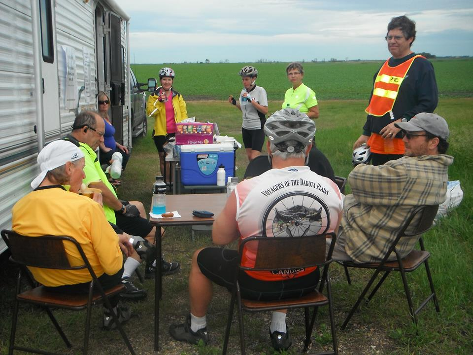 Riders taking a break along the road, good times with old and new friends.