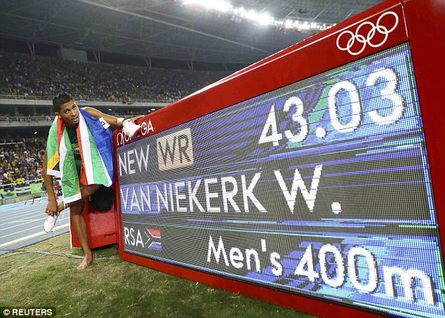 Wade van Niekerk breaks Michael Johnson's 400m record that has stood since 1999