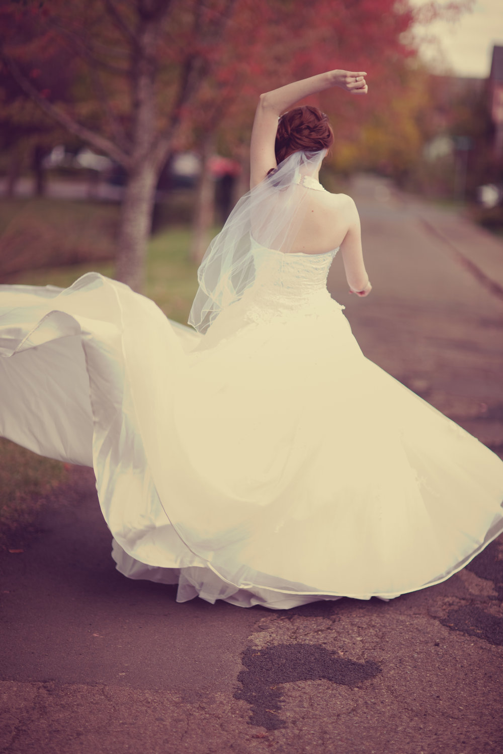 Bride walking away: View of bride walking away in full-skirted wedding dress, cut to create graceful movement
