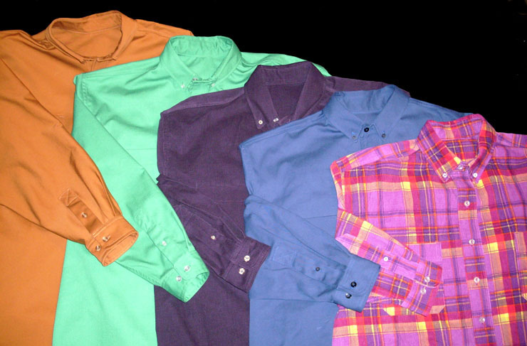 Four copies of a favorite men's tailored shirt in different colors and patterns