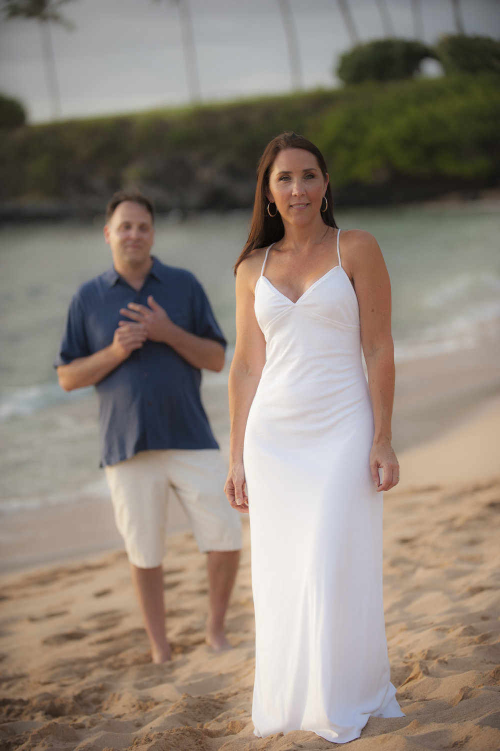 White jersey knit wedding dress in sleek body-hugging design for Hawaiian beach wedding