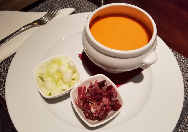 Gazpacho with diced cucumber and Iberian ham for toppings