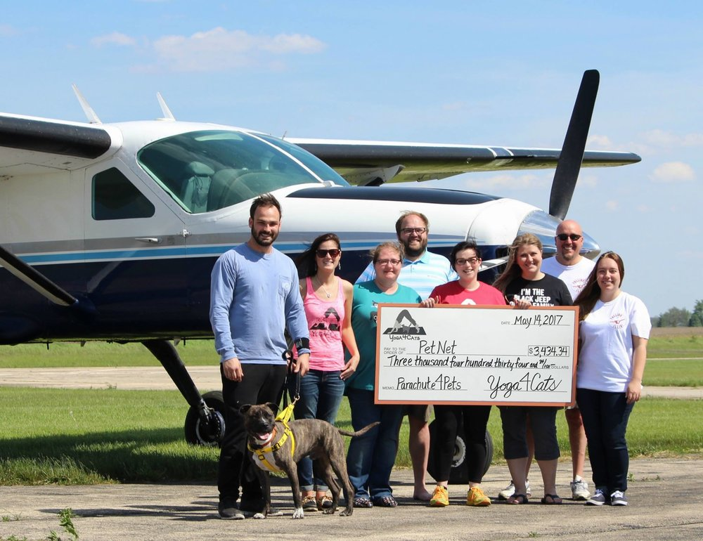 We are pleased to announce that Parachute4Pets raised $3,434.34 for  PetNet ! Thank you to our event sponsors, auction donors, PetNet volunteers,  Illinois Skydiving Center , and everyone that joined us at the event!   Pictured left to right: Ghost [adopted], John Vetter, Jeanette Skaluba, Misty Adcock, Daniel Papuga, Erin Rockafellow, Emily Price, Jef LeRette, and Savannah LeRette.  Not pictured: Melanie Bilbrey and Abby Prince.
