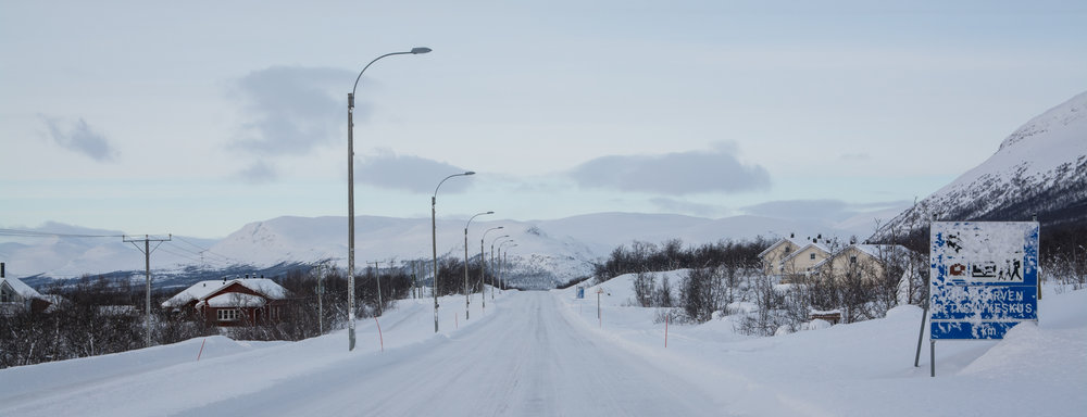 Kilpisjärvi, a tiny arctic village that occupies the northwest cape of Finnish Lapland. Norway and Sweden are visible in the background of this picture. There is no connecting bus service from the nearest town, Skibotn (Norway), during the dark winter months.