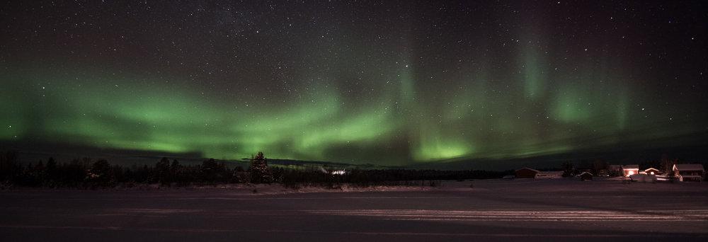 A faint aurora along the Ounasjoki river.
