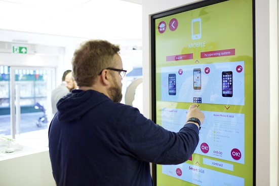 Interactive touch screens assists shoppers to make purchases.