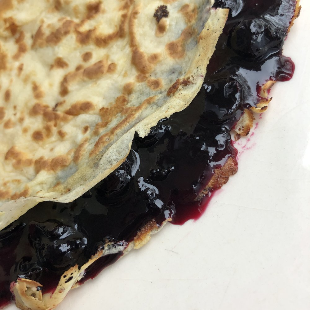 pancake with blackcurrant preserve
