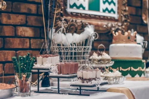 Assorted dessert tables not only add a cool design aspect to your wedding, but can also help cut costs.