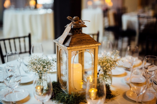 Non floral centerpieces can mean lanterns, assorted vases, candles, or any creative and personal items you love.