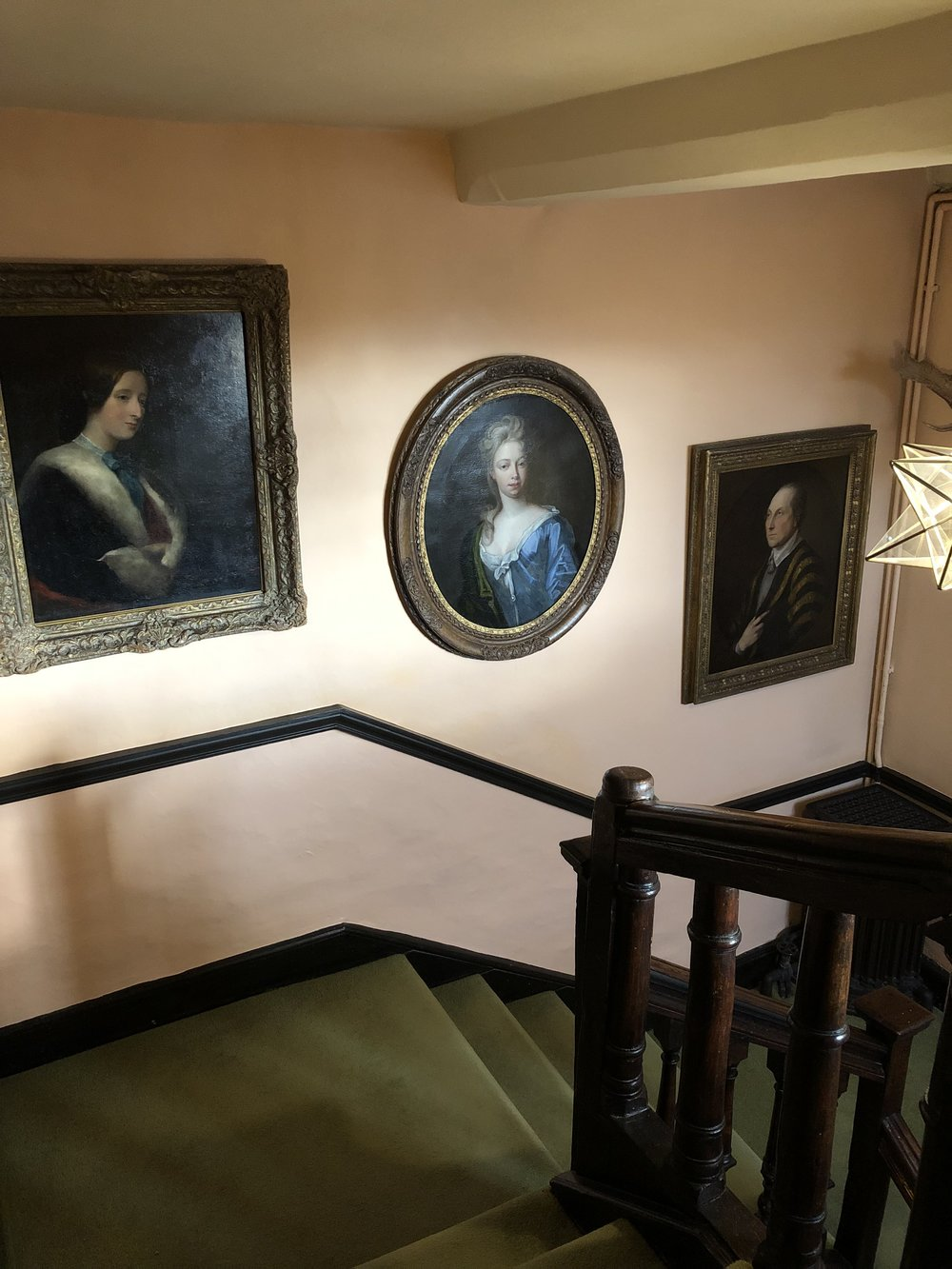 Portraits on the Staircase.
