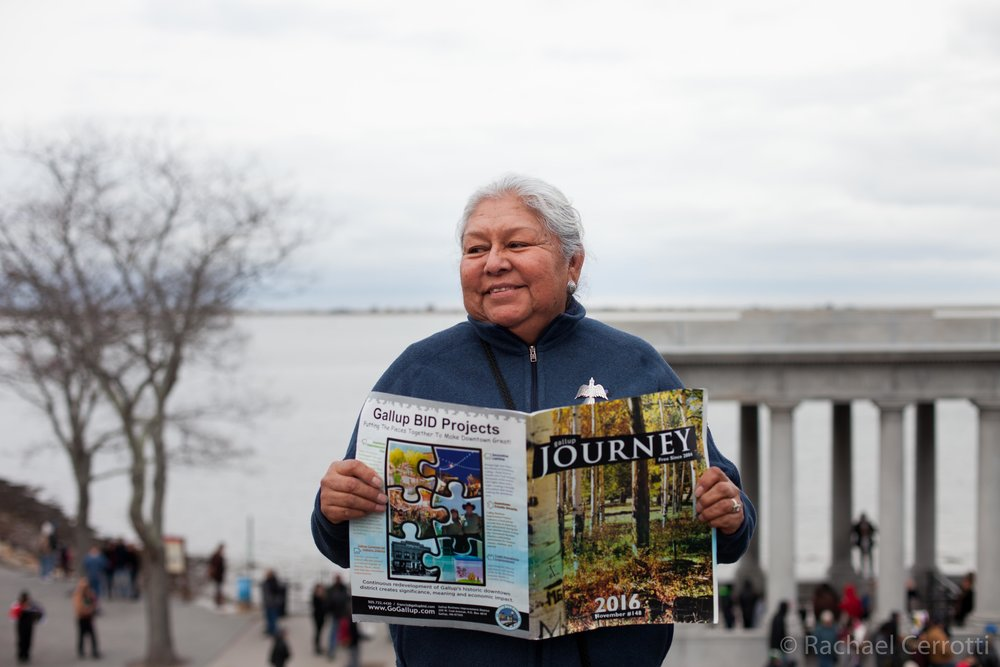 Angelina Boone of Gallup, New Mexico is from the Navajo Nation. Standing in front of the monument at Plymouth Rock, she holds the a local publication from Gallup.