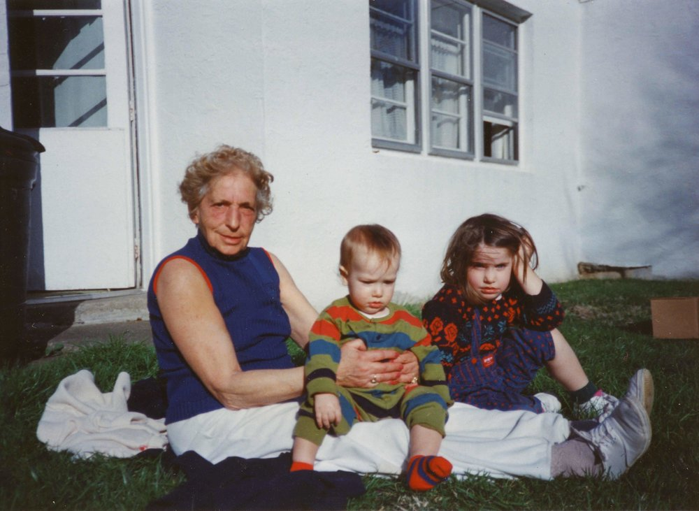 Rachael (right) with her younger brother and grandmother, Hana, in the early 1990s.