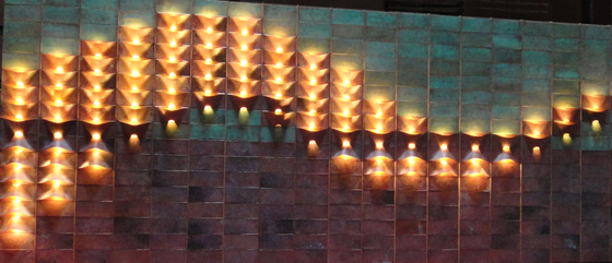 Lum copper and verdigris wall light installation from Quasar
