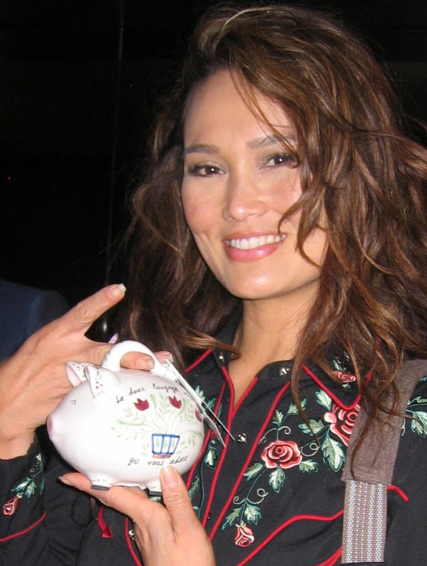 General Hospital actress Tia Carrere with her Country Piggy Bank.