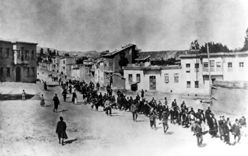 Ottoman Armenians are marched to a prison in Kharpert, Armenia, by armed Turkish soldiers in April 1915. Up to 1.5 million Armenians were killed in what is now recognized as the 20th century's first genocide.   (PROJECT SAVE / NEW YORK TIMES)