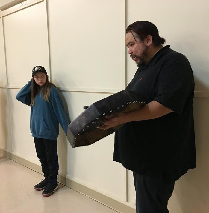 On the right, Tsumkwatun (Councilor Lawrence Mitchell, Snaw-naw-as First Nation) sings a song with his daughter (left) after hosting a meal for CBRA on behalf of the Nation.