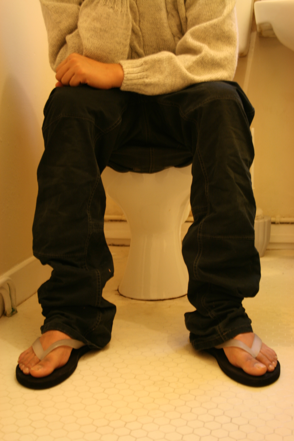 man-sitting-on-toilet.jpg