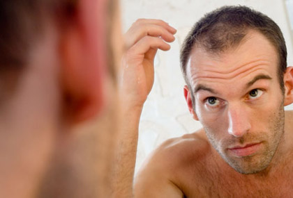 Hair-Loss-Man-looking-in-the-mirror-The-Belgravia-Centre