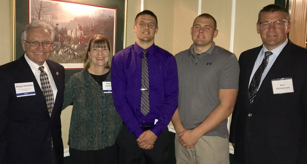 John Christensen from Suring High School with his brother Cody who received the scholarship a few years ago.  They are pictured with their dad, Ron and Doug and Renee LaViolette