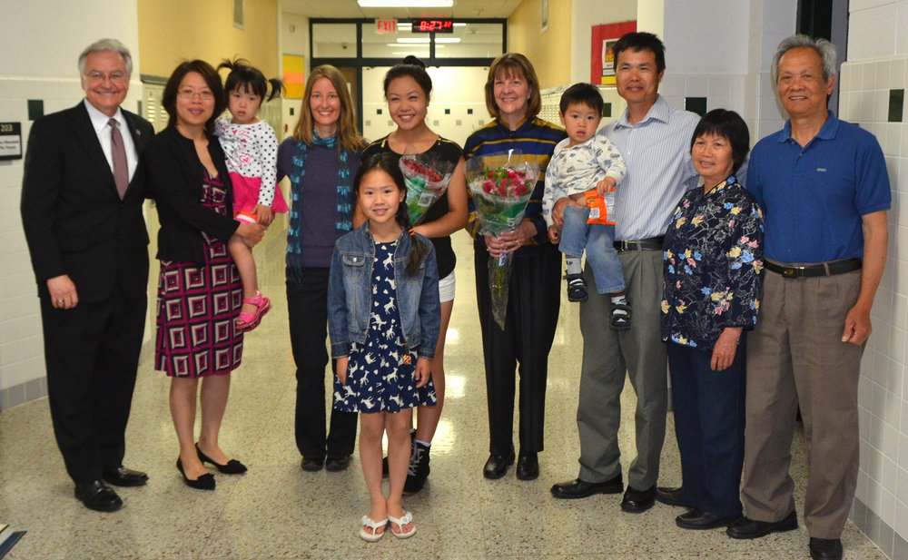 Donglin with her family in 2015 after we surprised her at Ashwaubenon High School with the news that she received the $10,000 Brian LaViolette Scholarship