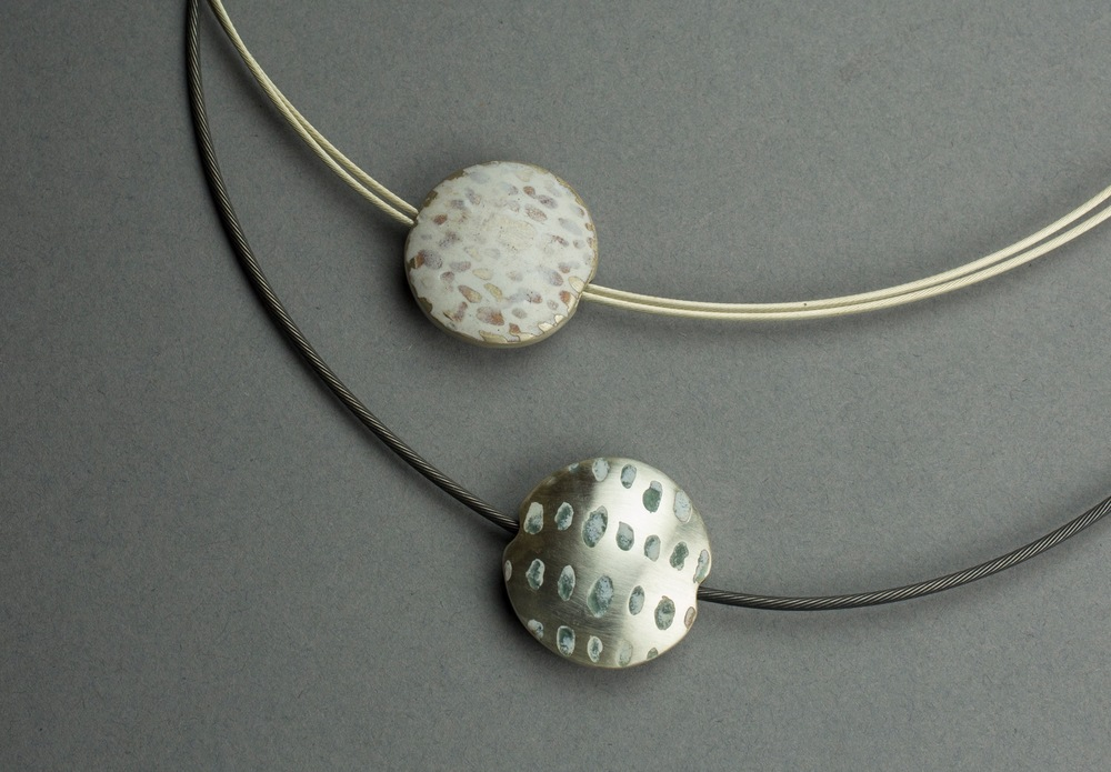 Double sided round pendants