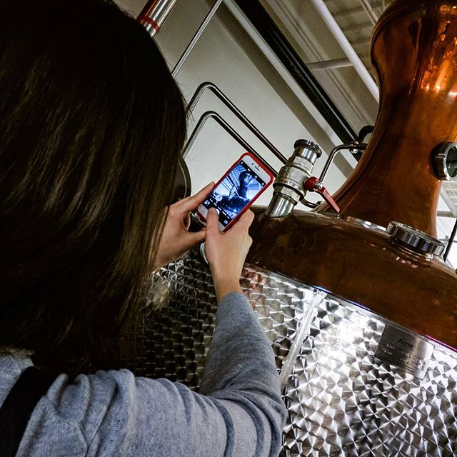 Photos of people taking photos are so meta. Navy strength gin from @districtmagnus is the best gin I've ever had. #wheelswithinwheels #metaphotography #distillery