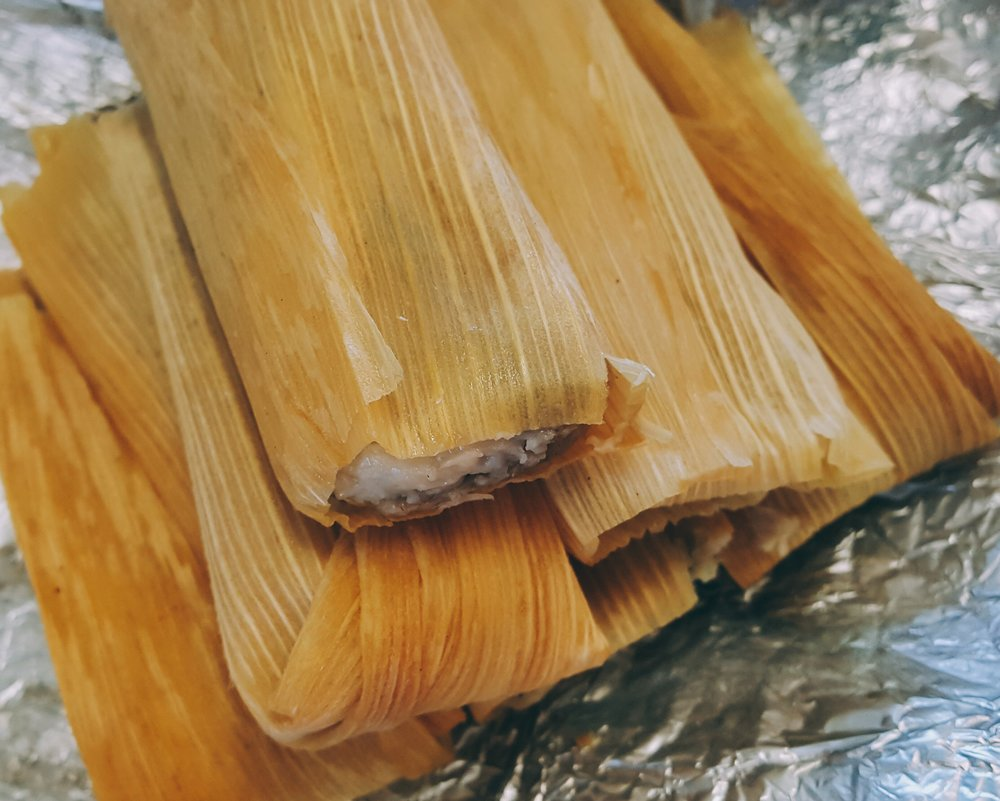 Come try a delicious handmade traditional tamale today! We have something for everyone! Choose from our flavors Hatch Chile Shredded Pork (Hot), Chicken (Medium), Shredded Beef (Mild), Jalapeno, Bean, and Cheese (Hot), Jalapeno and Cheese (Hot), and Spinach and Cheese (Mild). Our Vegan Tamales will be a hit with any animal or meat lover! Choose from our flavors Meat and Potatoes with Red Sauce, Hatch Chile and Cheese, Brown Sugar Rum, and Raisins, Jalapeno and Cheese, and last but not least, Beans and Cheese.