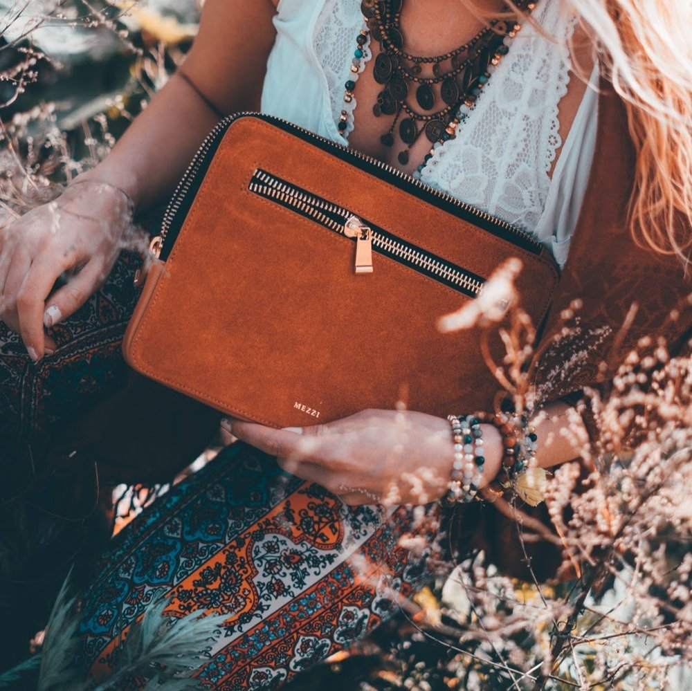 mezzi tech handbag, charging handbag, handbags that charge your phone, indie twenty, indie brand rep, handmade jewelry, ryan kell photography, buffalo designer, small business buffalo, boho handbags, suede tech clutch, patterned bells, patterned pants, boho outfit inspiration