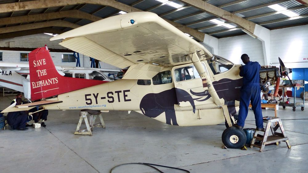 An engineer performs maintenance on the Cessna 185 engine STE urgently needs a second plane to double operational capacity and maintain their presence across eastern Africa through airborne missions.