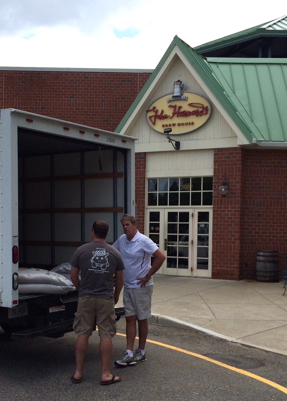 Aaron Crossett, Head Brewer, John Harvard's Brewery takes delivery from Mark