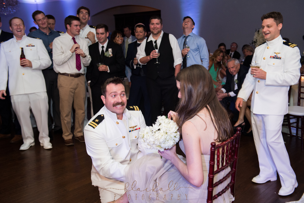Maybe a bit awkward, maybe a bit funny...the groomsman that caught the garter had to put it on the bridesmaid that caught the bouquet!