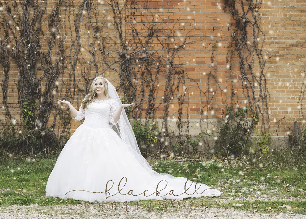 Could be a little Blackall Photography magic or It may have started snowing a little during her session?? ;)