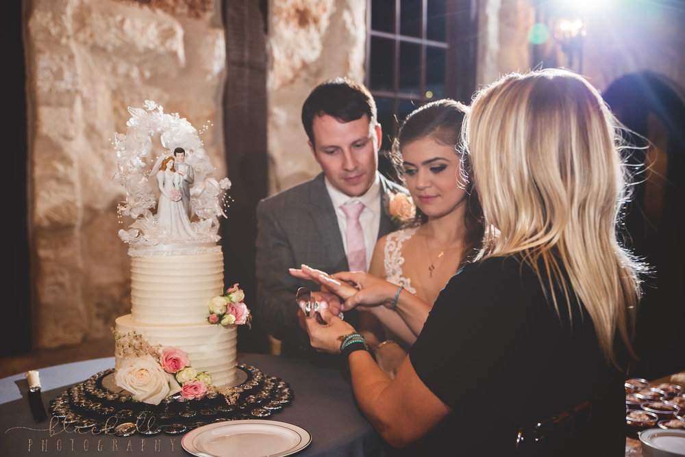 Sometimes I wear multiple hats during a wedding and I love it! Helping direct a little cake cutting!