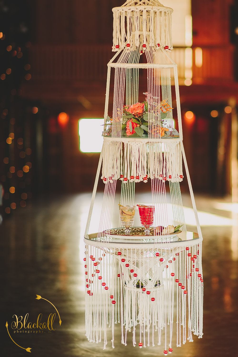 Cheers! What a original way to deliver drinks to the bride + groom! I love this Macrame Hanging Table!!