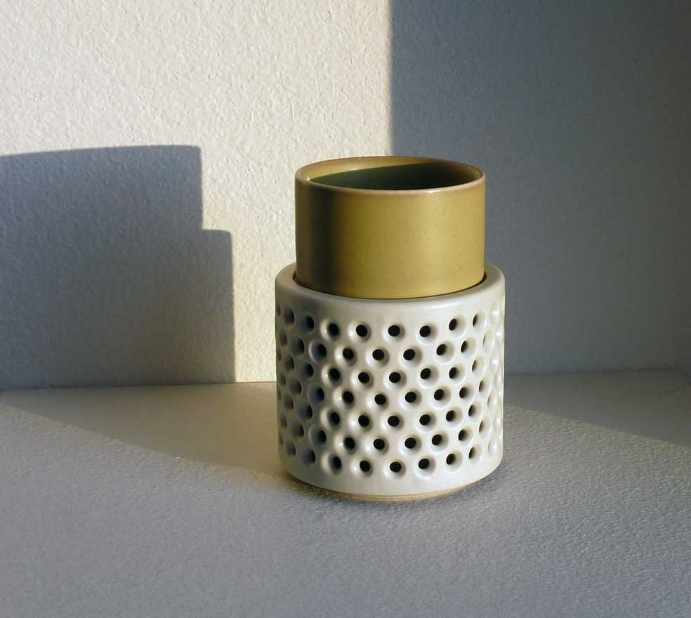 """double walled cup with perforated """"handle"""""""