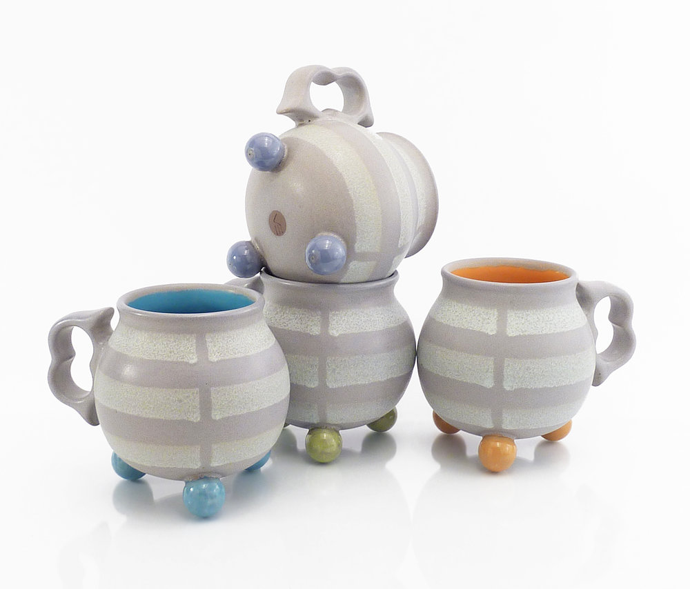"Ball footed ""broken stripe"" mugs"