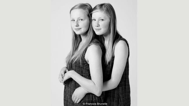 "These girls are not related. Francois Brunelle has photographed more than 200 pairs of dopplegangers for his ""I'm Not a Look-Alike"" project. (Credit: Francois Brunelle)"
