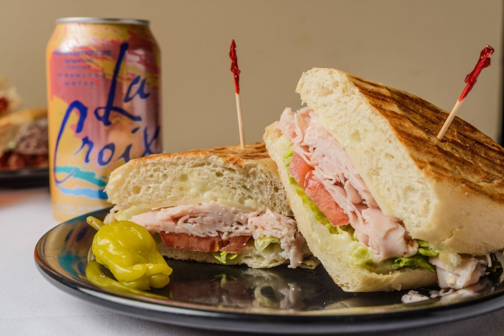 The Choice $8.50 - Ham, turkey or roast beef, with lettuce, tomatoes, provolone cheese, mayo or mustard, served on Italian Roll