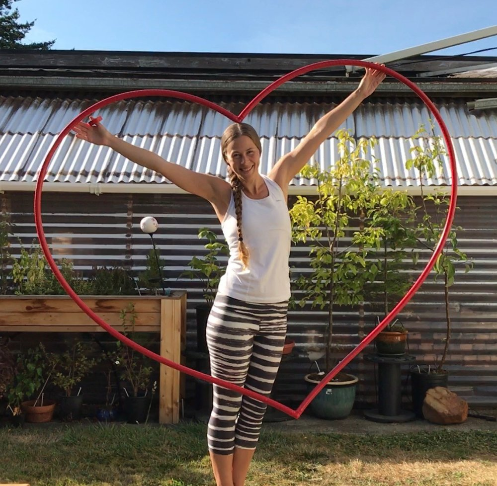 Ayla Joy Love-  That's me, holding a heart I made out of hoop materials.    Photo by Mark Goodman.