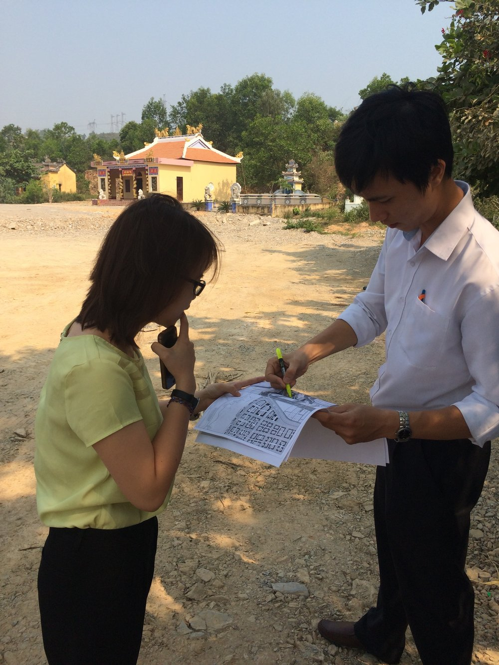 Reviewing plans at the site of the new water treatment plant in Da Nang, Vietnam