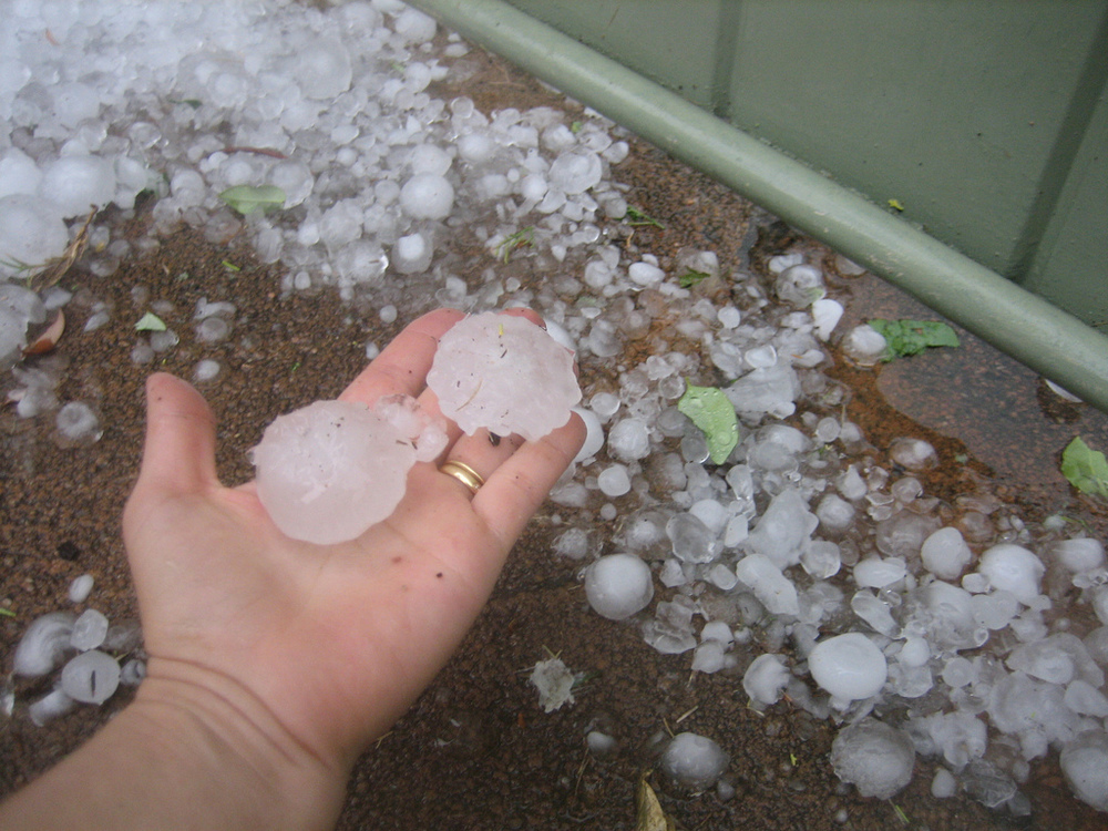 Perth_hail_size_compared_to_hand.jpg