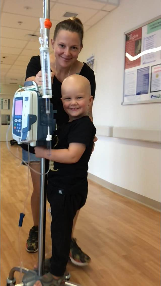 Riley's nurses know to fetch the fastest moving IV pole in the ward when we arrive, he loves to ride it down the hall like this
