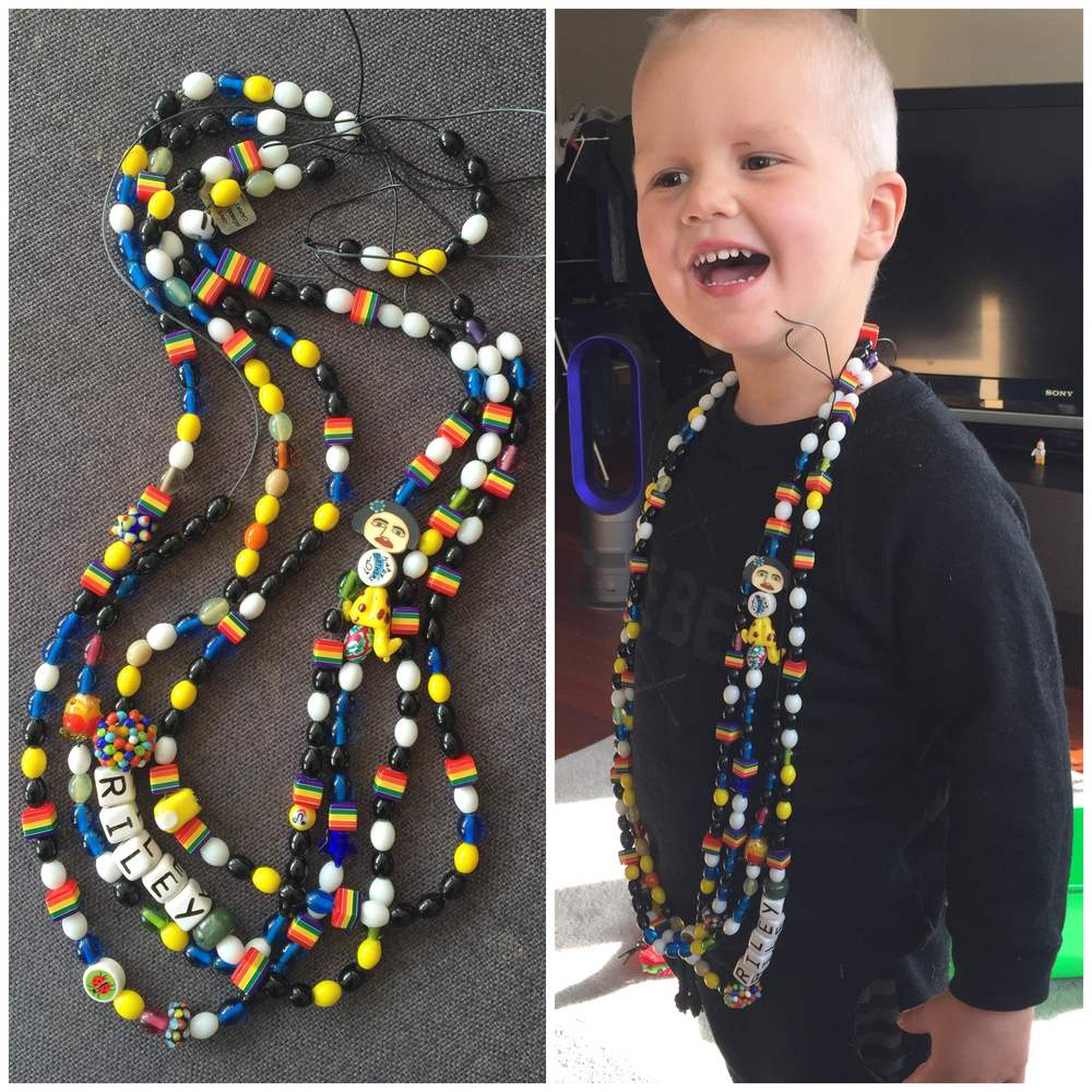 Riley with his Beads of Courage. He received one for each procedure he went through including, needles (black), chemo (white) and overnight hospital stays (yellow).