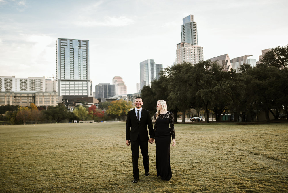 Who says black and blue don't match? When done right, it can be so glamorous! Here, Luis wears a classic black suit while Jenn dons a long navy gown.