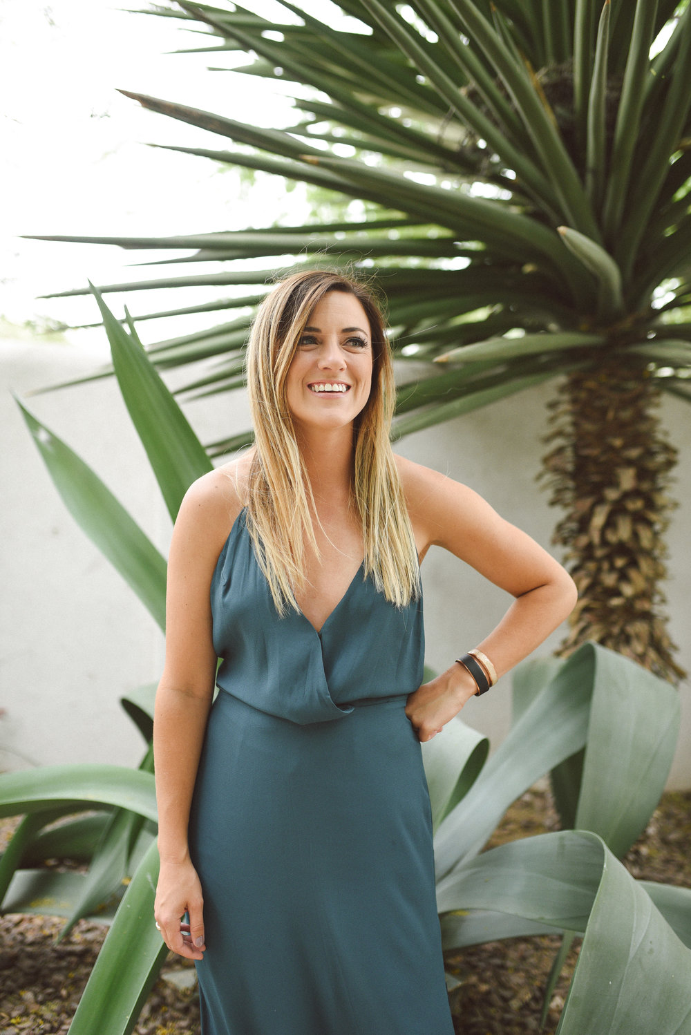 A flowy, jewel toned dress and minimal accessories leave all the attention on Brittany and her surroundings! With jewelry LESS IS MORE. Fun fact: I loved these custom cuffs so much, I ordered some for myself! Check the out  here .