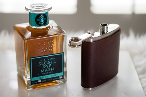 leather-wrapped flask available with branded monogram