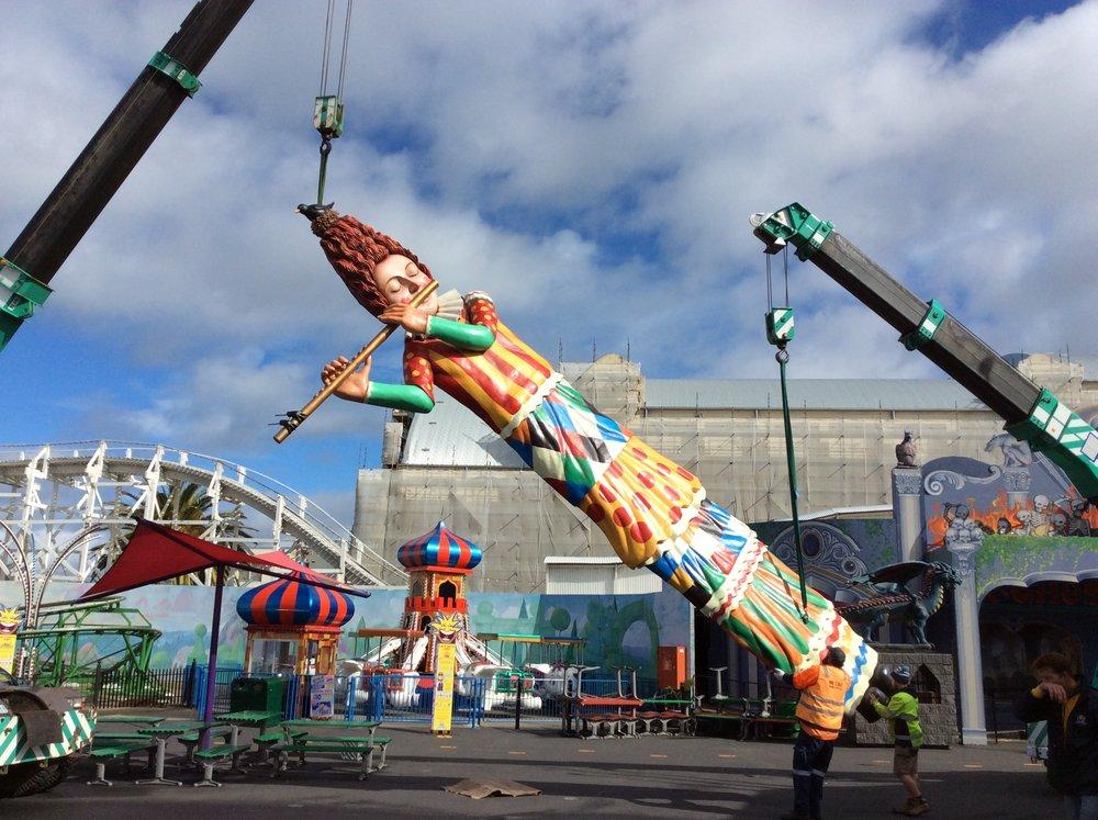 Flautist figure being installed, Luna Park Melbourne, September 2015.