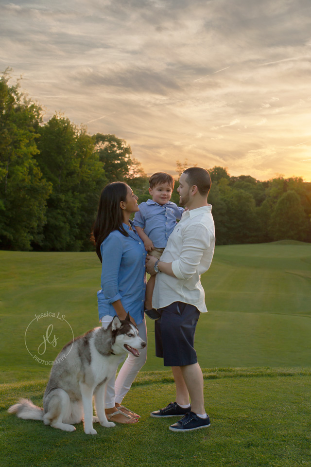 Family Photograph with husky dog and 2 year old boy at sunset in Woodbridge VA with Jessica LS Photography