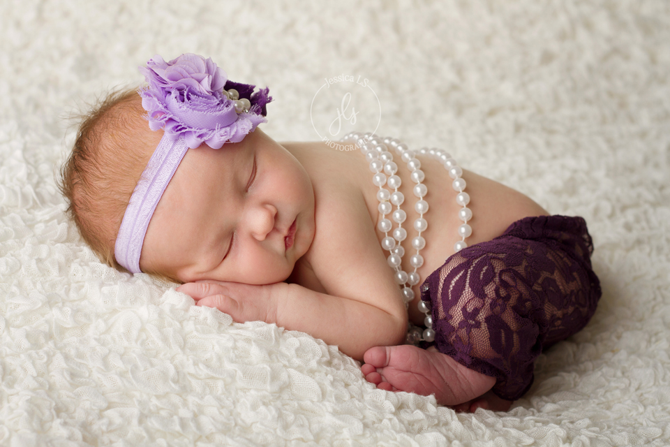 Beautiful baby Mackenzie looks so lovely in pearls and purple (which happens to mom's favorite color too!). She slept wonderfully during her session, but silly me forgot to take photos of just mom and baby!  When she finally came back a week later, she was wide awake!